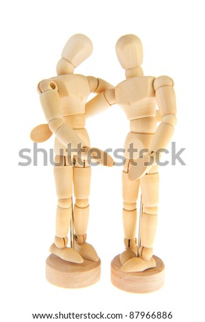 Wooden dolls together in love isolated over white background