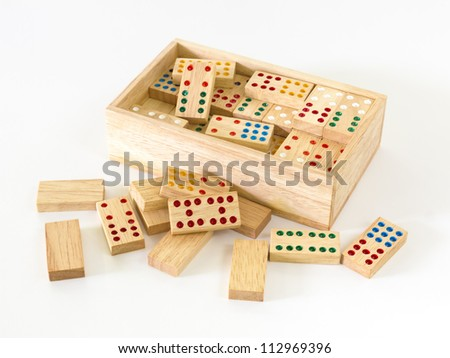 Wooden Domino in wooden box against the white background - stock photo