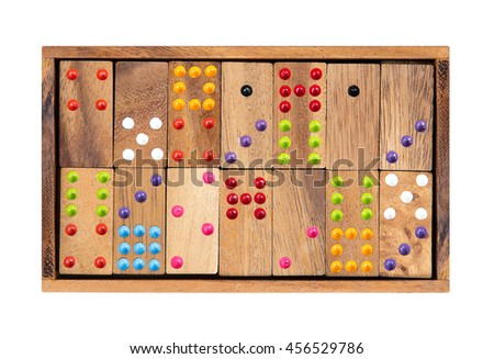 Wooden dominoes in a wooden box isolated on white background - stock photo