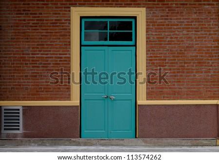 wooden door  and brick wall - stock photo