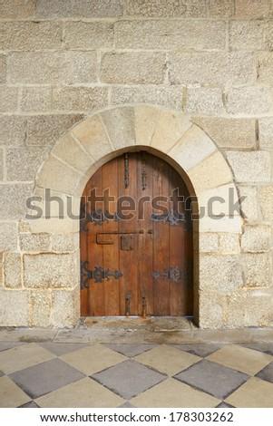 wooden door at castle in Guimaraes, Portugal - stock photo