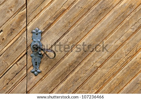 Wooden door background with keyhole - stock photo