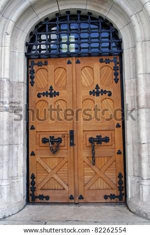 Wooden door. Heavy wooden door. - stock photo