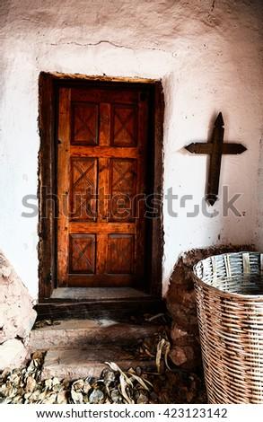 Wooden Door in Adobe Home - stock photo