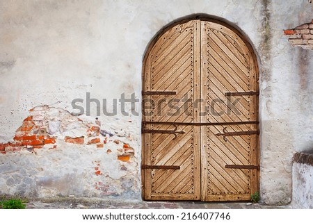 Wooden door in an old style. Courtyard of the old castle - stock photo