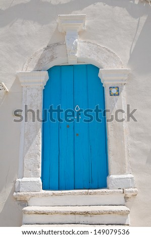 Wooden door. Mattinata. Puglia. Italy.  - stock photo