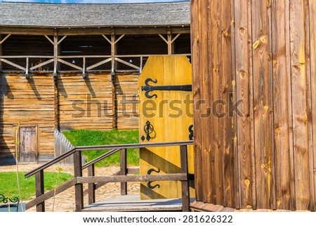 """Wooden door of an old wooden orthodox cossack church situated in the """"Baturin Citadel"""" historical complex. Baturin, Ukraine. - stock photo"""