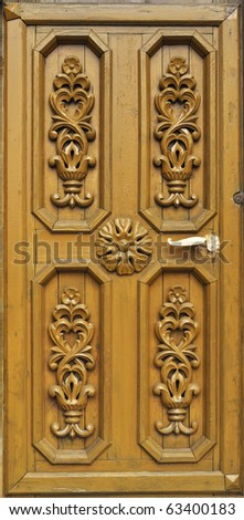 Wooden door of country house with carved ornament, Russia - stock photo