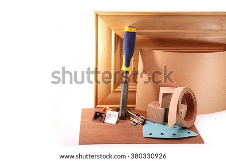 Wooden door of maple for kitchen cabinets, chisel, hinges, veneer on a white background - stock photo