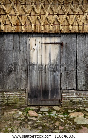Wooden door of old barn. - stock photo