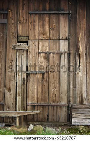 Wooden door of old barn - stock photo