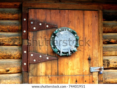 Wooden door with an unusual nautical porthole window and large hinges & Wooden Door Unusual Nautical Porthole Window Stock Photo 74401951 ... pezcame.com