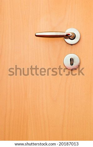 wooden door with metal handle - stock photo
