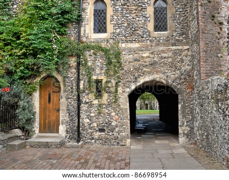 Wooden doorway and arched walkway in the Precincts of Canterbury cathedral