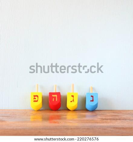wooden dreidels for hanukkah (spinning top) - stock photo