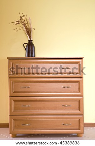 wooden dresser and decoration - stock photo