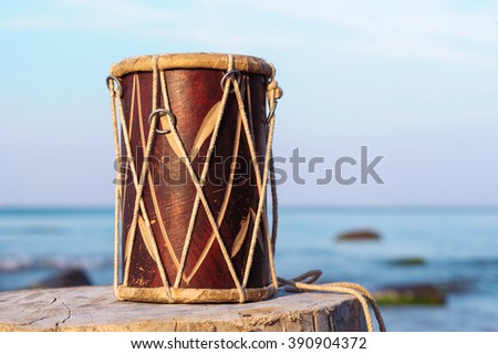 Wooden drum on the stump at the sea - stock photo