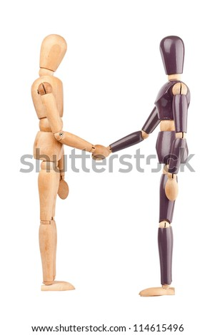 Wooden dummies shaking hands isolated on a white background - stock photo