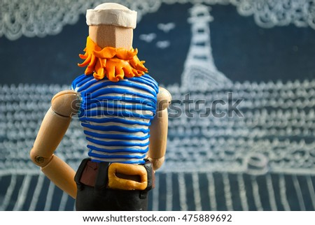 Wooden dummy as a sailor man with red beard.