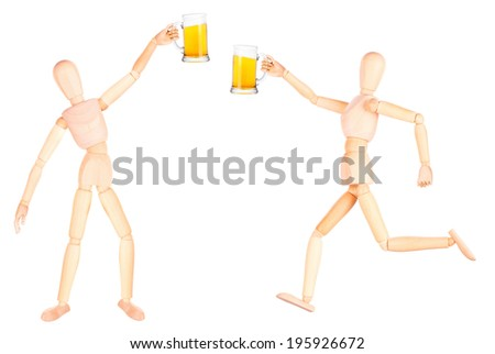 wooden Dummy with frosty glass of light beer making toast Isolated Over White Background - stock photo