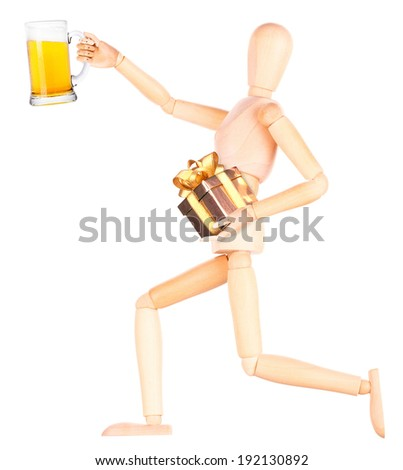 wooden Dummy with glass of beer and gift Isolated Over White Background - stock photo