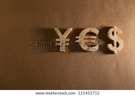 Wooden economy and currency unit on a craft background - stock photo