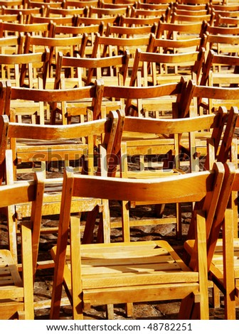 Wooden empty chairs on sunlight - stock photo