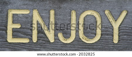 Wooden ENJOY sign
