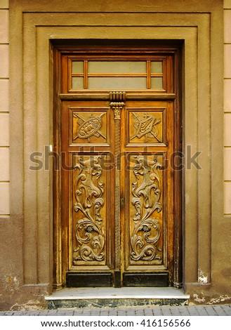Wooden entrance door in Madrid, Spain - stock photo