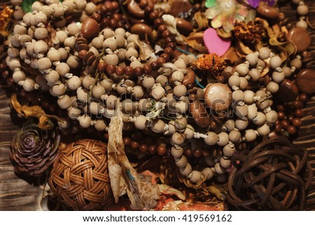 Wooden ethnic necklaces and bracelets closeup - stock photo