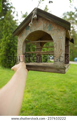 Wooden feeders for birds in the Park - stock photo