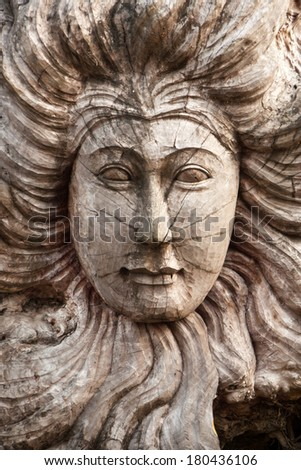 Wooden female sculpture face