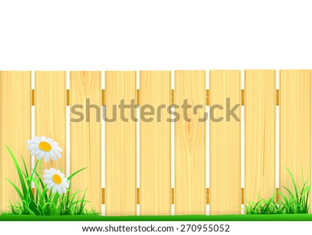 wooden fence and green grass - stock photo