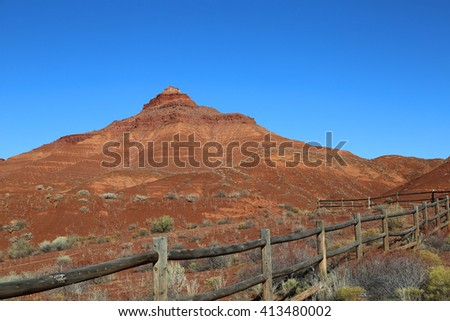 Wooden fence and red monument -Castle Valley,  Utah - stock photo