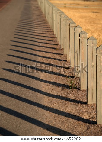 Wooden fence at sunset