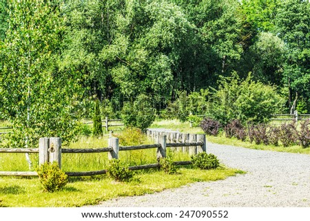 Wooden fence in countryside of Belarus. - stock photo