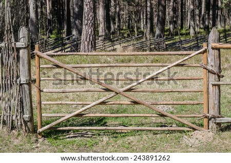 Wooden fence in the spring in the countryside - stock photo