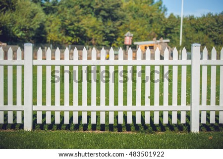 Wooden fence in white color in the park