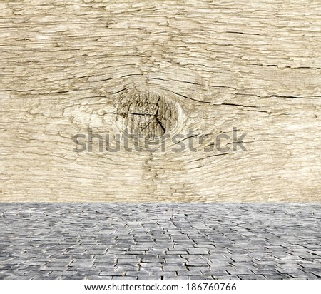wooden fence rough background and vintage stone pavement foreground