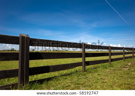 Wooden Fence Under Blue Sky - stock photo