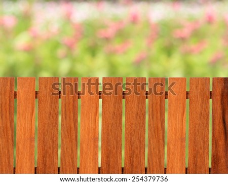 Wooden fence with flowers background blur this has clipping path. - stock photo