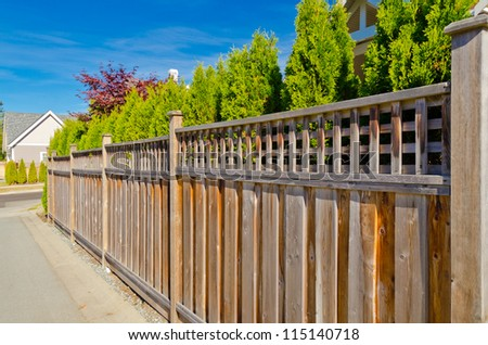 wooden fence with green trees