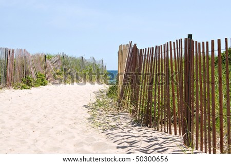 Wooden fences lining the entrance to the Rhode Island beach. - stock photo