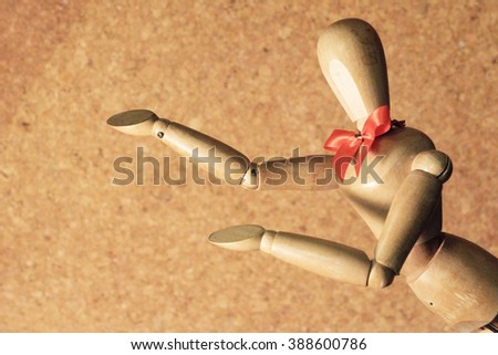 wooden figure action emotion present