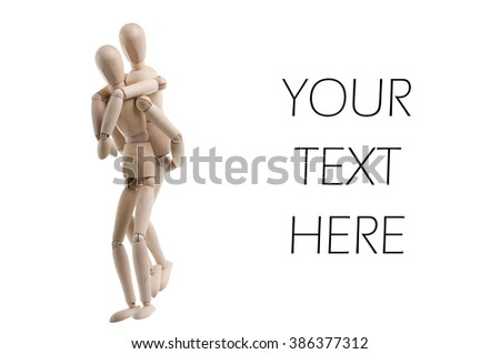 Wooden figure giving a piggyback ride, isolated on white. - stock photo