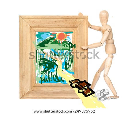 Wooden figure hold wooden frame with picture of road cut through forest isolated on white,environment concept