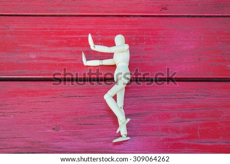 Wooden figure  stop show the hand - stock photo