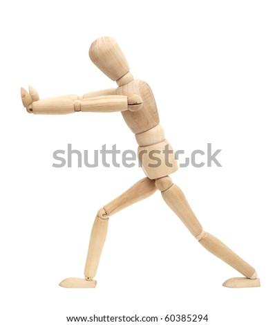 Wooden figure walking isolated on white background - stock photo