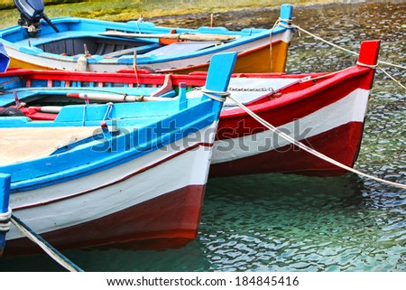 Wooden fishing boat in the sea closeup in Sicily - stock photo