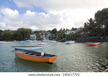 Wooden fishing boats in ocean in harbor on Mauritius - stock photo